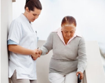 caretaker helps elder woman