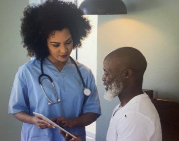 nurse showing a list to elder man