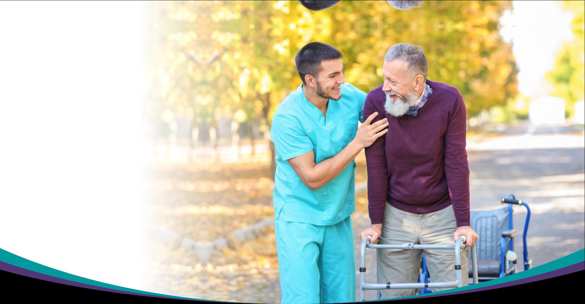caretaker helps elder man with walker
