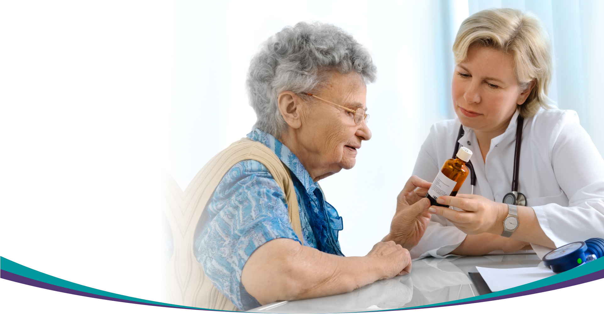 doctor shows medicine to elder woman
