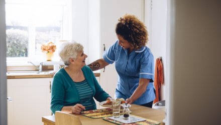 caregiver serving meal to a senior