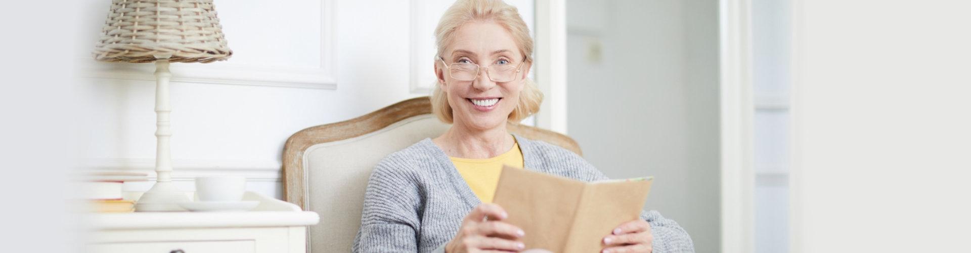 senior woman holding a book