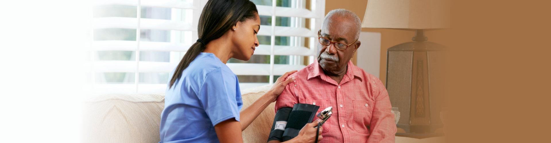 nurse checking her senior patient